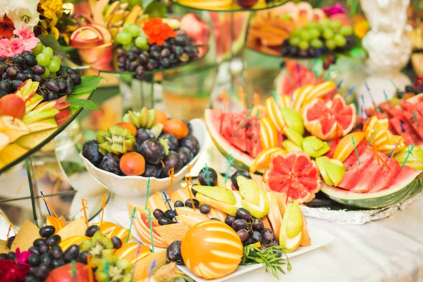 Authentic buffet, assorted fresh fruits, berries and citrus. Preparation for design creative menu.