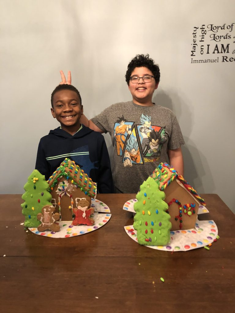 Lou Santini with two kids from church with gingerbread houses