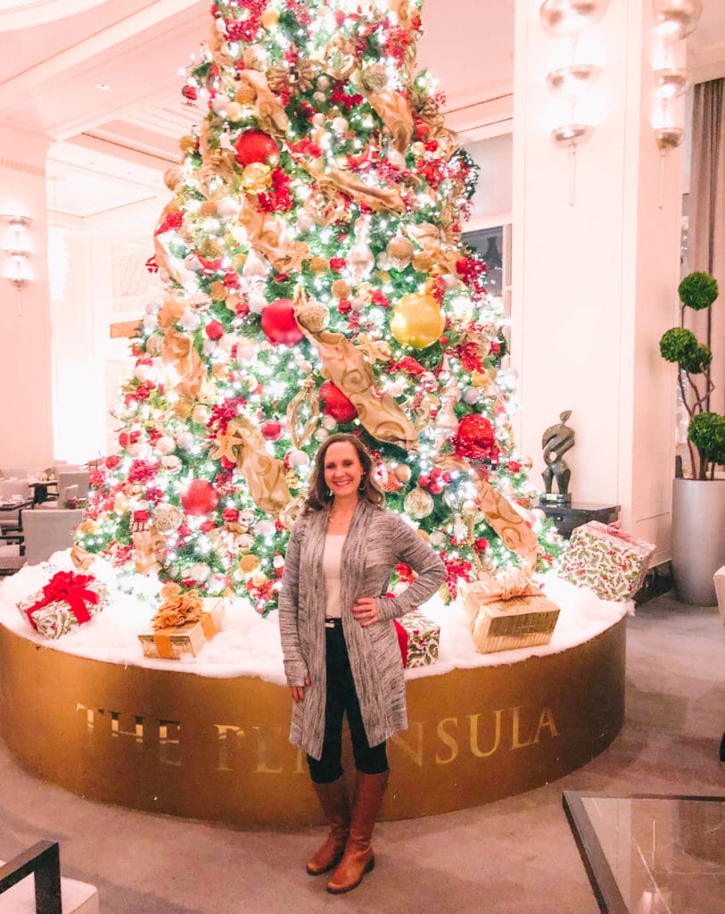 tami santini standing beside the peninsula in chicago christmas tree