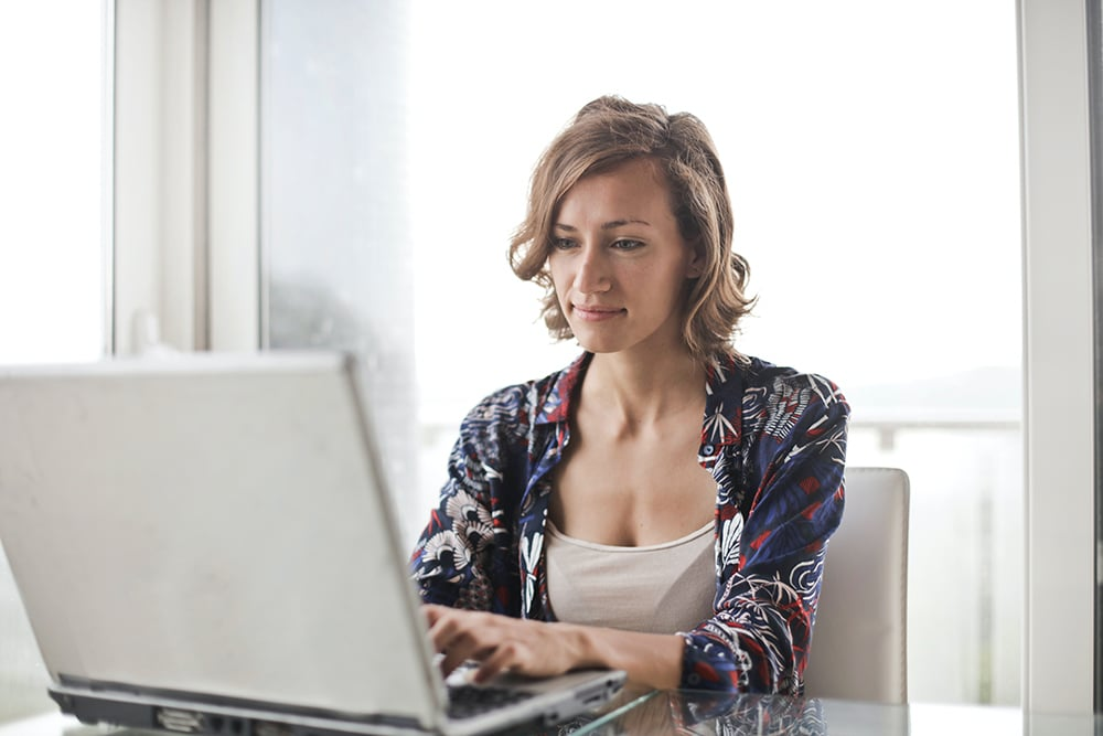 woman working with her marketing message on laptop