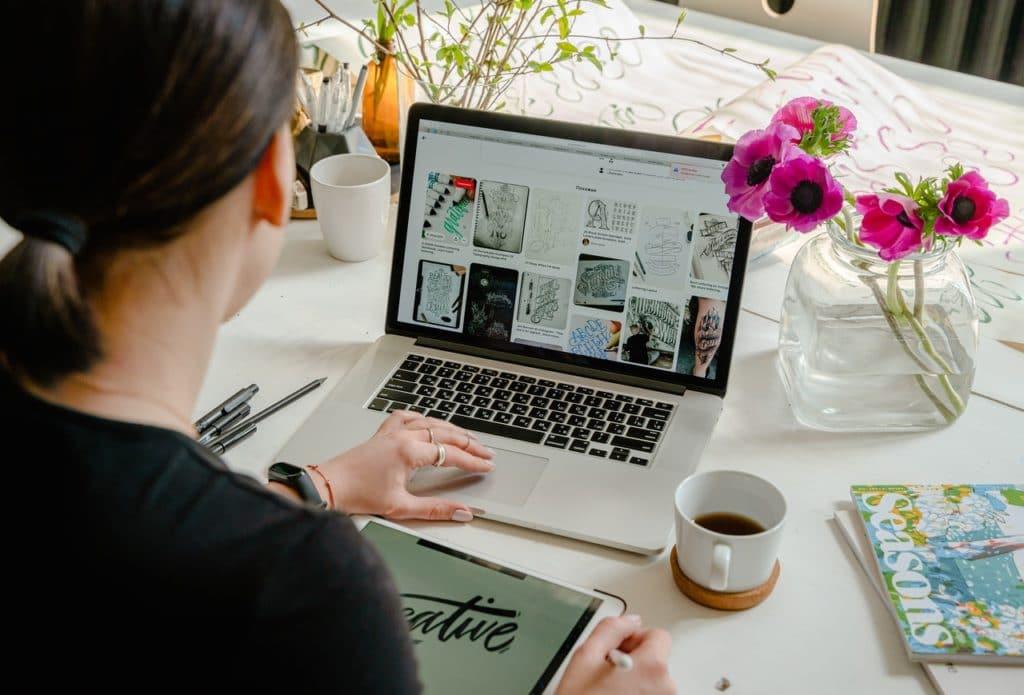 woman on laptop working on her destination wedding advertising