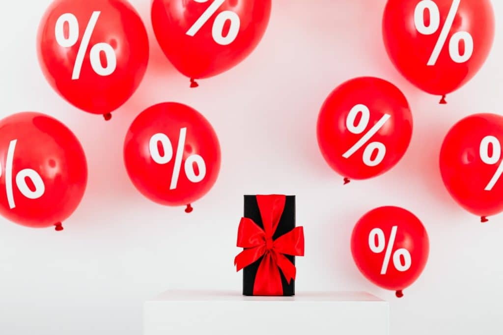 gift with red ribbon and red balloons